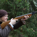 Woman aiming — Stock Photo #1088154