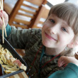 Little girl in restaurant — Stock Photo