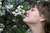 Woman and bird cherry tree — Stock Photo