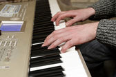 Playing the digital piano — Stock Photo