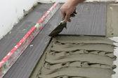 Laying Ceramic Floor Tiles — Stock Photo