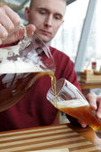 Man pouring beer — Stock Photo