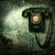 Old phone on the destroyed wall - Foto Stock