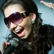 Foto Stock: Girl Singing