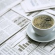 Stock Photo: Coffee over newspaper