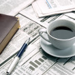 Cup of coffee on the newspaper - Stok fotoğraf
