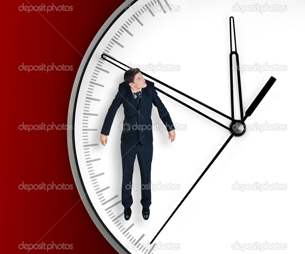 Businessman hangs on an arrow of clock, isolated on red background — Stock Photo #1037990