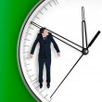Businessman hangs on an arrow of clock — Stock Photo