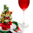 Foto Stock: Glass of red wine and Christmas decorati