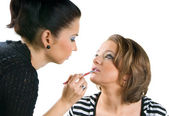 Makeup artist applying lipstick using li — Foto Stock