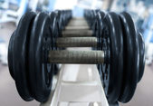 Barbell on blue background — Stock Photo