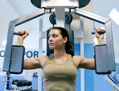 Girl in fitness club — Stockfoto