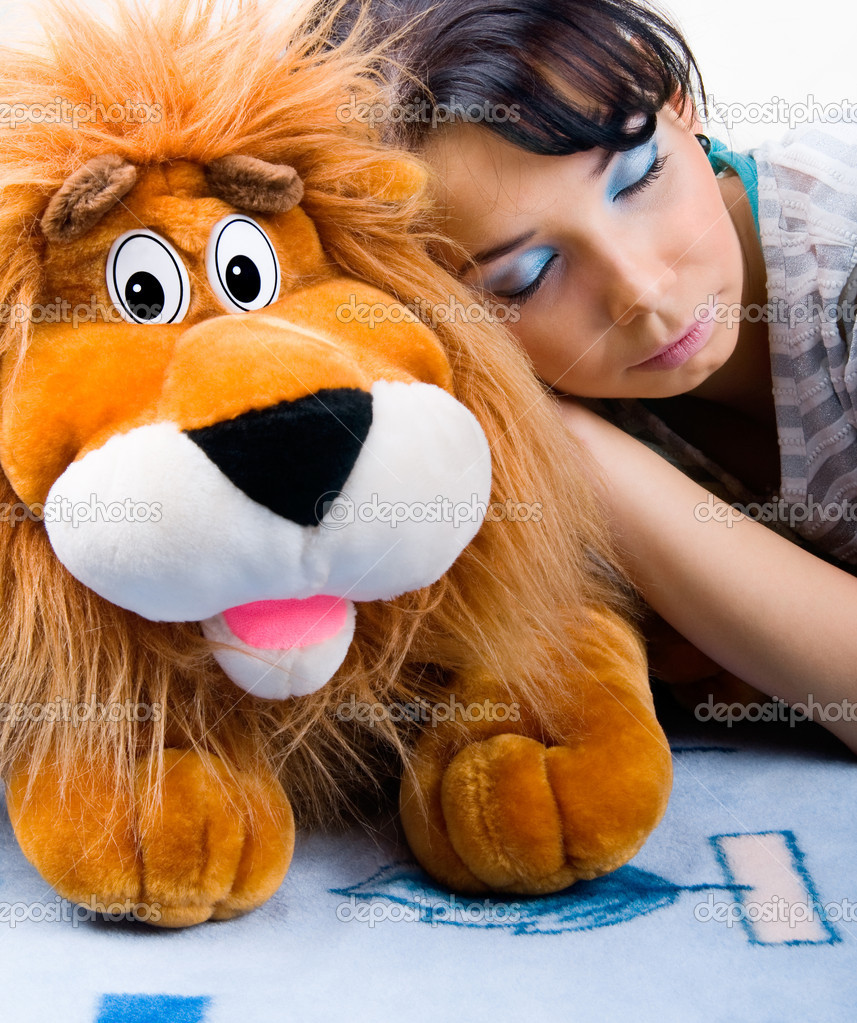 Beautiful sleeping girl with her Plush lion — Stock Photo #1087233