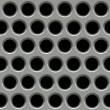 Stock Photo: Metal surface with holes.