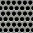 Metal surface with holes. — Stock Photo