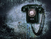 Old phone on the destroyed wall — Photo