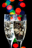 Champagne Glasses with Sparkling Ligh — Stock Photo