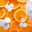 Stock Photo: White pills with oranges