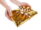 Christmas present in the hands — Stock Photo