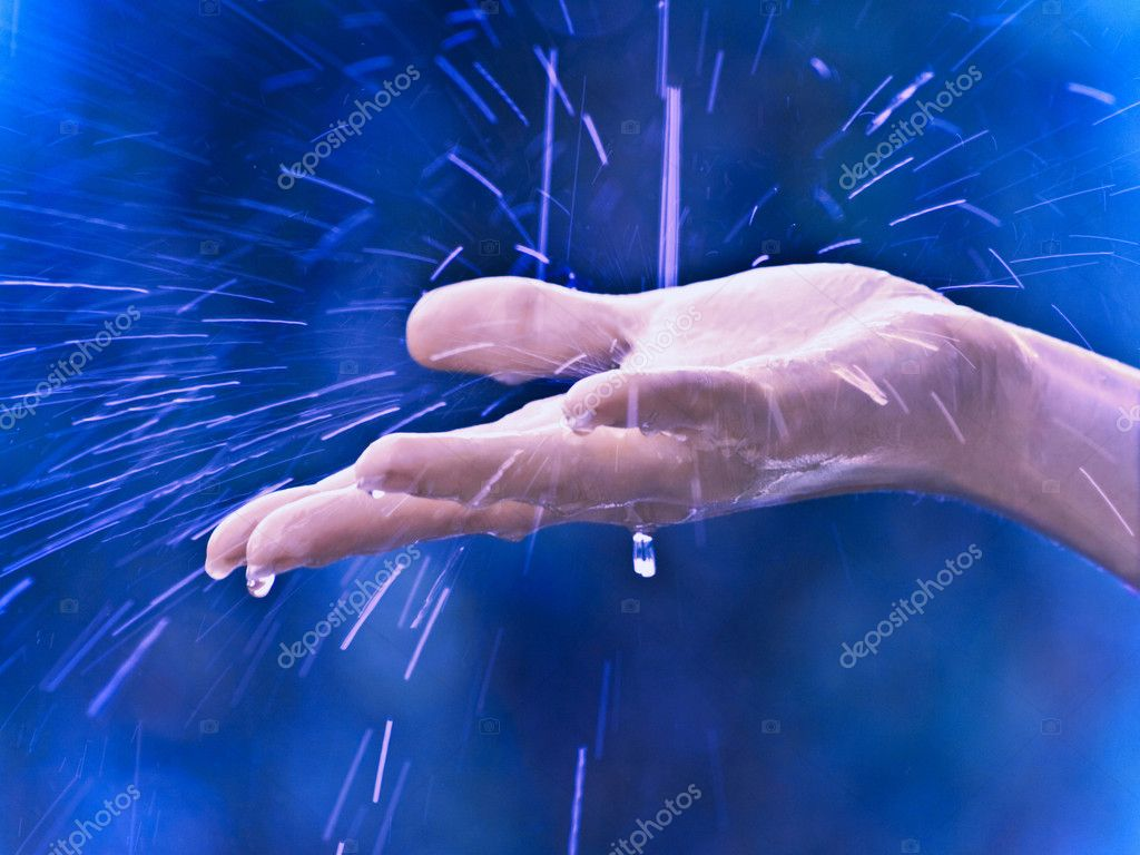 Hand and raindrops — Stock Photo #1045886