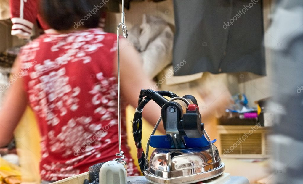 Pro steam-flatiron in laundry  Stock Photo #1045959