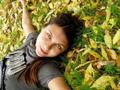 The young girl in autumn park — Stock Photo
