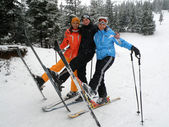Happy friends on ski resort — Stock Photo