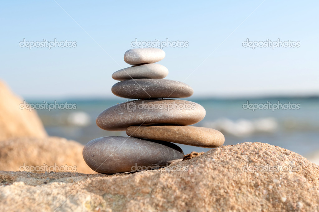 Pile of pebble Stones over blue ocean and blue sky  Foto de Stock   #1249880