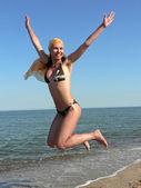 Happy girl on the beach — Stock Photo