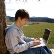Stock Photo: Teenager outside with laptop