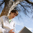 Teenager outside with laptop — Stock Photo #1274542