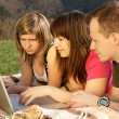 Three students studying outdoors — Stock Photo #1274667