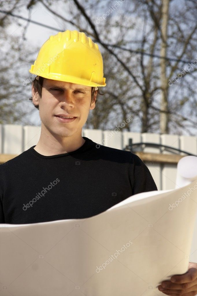 Architect Reviewing Blueprint  Stock Photo #1274752