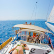 Sunbathing on a sailboat — Stock Photo