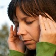 Young woman with headache — Stock Photo #1636871