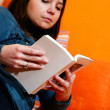 Stock Photo: Cute girl reading a book
