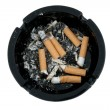 Royalty-Free Stock Photo: Cigarettes in the black ashtray