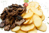 Liver and chips — Stock Photo