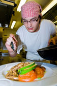 Chef's final touch — Stock Photo