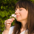 Real woman Smelling flower — Stock Photo