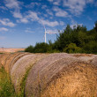 Bales of hay and windmill — Stock Photo