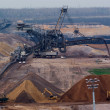 Giant spreader in an open pit — Stock Photo