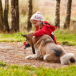 Little girl playing with her dog — Stock Photo