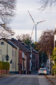 Wind turbine and small town in Germany — Stock Photo