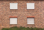 Wall of house in abandoned town — Stock Photo