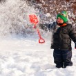 Stock Photo: Little boy playing with snow