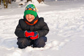 Little boy playing in winter forest — Stock Photo