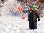 Little boy playing with snow — 图库照片