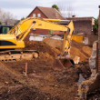 Excavator at demolition site - Stock Photo