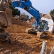 Excavator at demolition site — Stock Photo